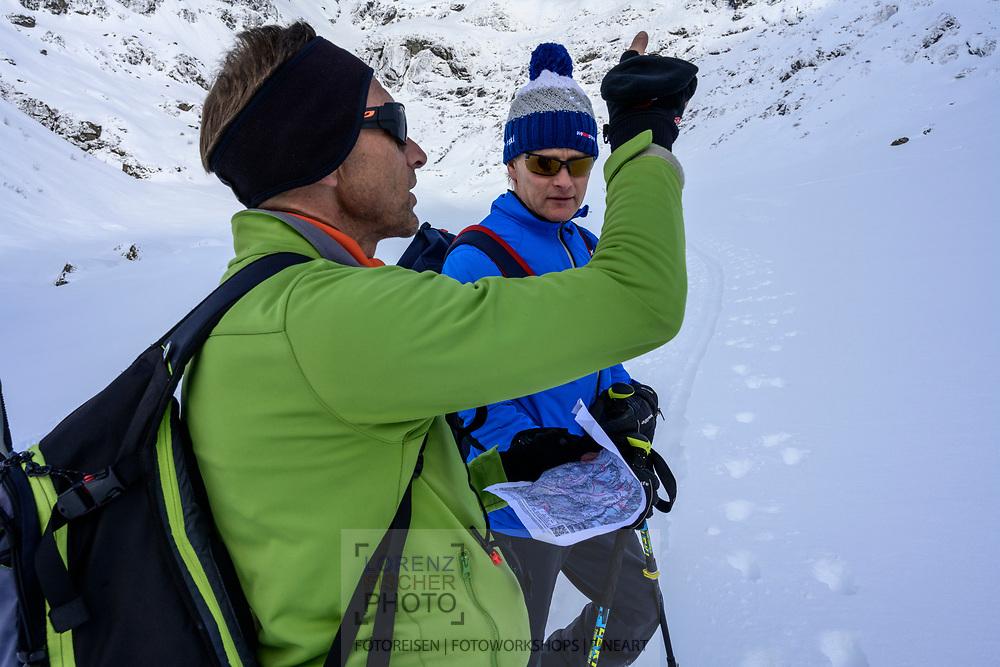 Finding the way on a ski tour from the Meiental on mount Zwächten with a descent to the Erstfeld valley, Uri, Switzerland<br /> <br /> Skitour vom Meiental auf den Zwächten mit Abfahrt ins Erstfelder Tal, Chlialp, Uri, Schweiz