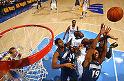 SHOT 4/28/2004--.The Denver Nuggets' Nene is no match for three Minnesota Timberwolves' Michael Olowokandi (#34), Sam Cassell (#19) and Kevin Garnett (in background) in the second quarter of the Nuggets 84-82 loss in the first round of the 2004 NBA. The Timberwolves lead the series 2-1 and would go on to win the series..(Photo by Marc Piscotty/ © 2004)..