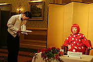 Japanese artist Yoyoi Kusama sits during a press conference for the 2006 Praemium Imperiale art awards, in the Hotel Okura, Tokyo, Japan, on Tuesday, Oct. 17,  2006. The five laureates in 2006 were internationally renowned  Japanese artist Kusama Yayoi, French sculptor Christian Boltanski, German architect Frei Otto, American musician Steve Reich, and Russian dancer ballerina Maya Plisetskaya. All receive an honorarium of 15 million Yen, and a medal. The Japan Art Association, giver of the awards, is the oldest cultural foundation in Japan, established in 1887. The laureates are chosen each year by an international jury, from a list of nominees put forward by advisors. The awards are held annually in Tokyo in the presence of Prince and Princess Hitachi.
