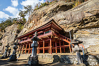 Takkoku no Iwaya Temple was built embedded in the rock wall of a cliff 1,200 years ago during the early Heian period.  The original Takkoku no Iwaya Bishamon Temple burned down and its original form is unknown today; the current building was reconstructed in 1961, modeled after Kiyomizu in Kyoto. There used to be 108 statues of Bishamonten, the Guardian of the North, of which 33 remain today. Takkoku no Iwaya was built and dedicated to the god of warriors in the 9th century, during the Japanese expansion northwards and the ensuing battles with the indigenous Emishi people. Takkoku no Iwaya is a UNESCO World Heritage Site.