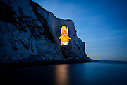 A giant projection of the Trump Baby lit up the White Cliffs of Dover on 1st June 2019 in Dover, United Kingdom. With the US President arriving in the UK this week, campaigners from the Trump Baby team, illuminated the cliffs with a projection of the baby. Trumps visit is expected to be met by widespread protest. The Trump Baby Inflatable, which captured the public's mood last time the President visited, is set to fly on Tuesday but only if a fundraising target of £30,000 is met to support groups affected by Trump's presidency.