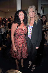 Left to right, JO MANUEL - founder of The Special Yoga Centre and GABY ROSLIN at The Special Yoga Centre's annual art auction held at the 20th Century Theatre, 291 Westbourne Grove, London W11 on 16th May 2011.