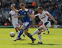 Photo: Steve Bond/Richard Lane Photography. Leicester City v Carlisle United. Coca Cola League One. 04/04/2009. Peter Murphy (R) clears in front of  Matty Fryatt (L)