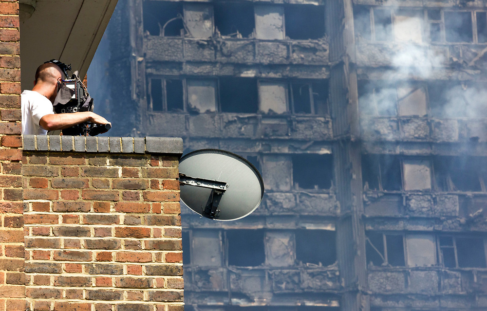 14 June 2017 taken between the hours of 16.27 - 18.50.<br /> <br /> The Grenfell Tower fire occurred on 14 June 2017 at the 24-storey, 220-foot-high (67 m), Grenfell Tower block of public housing flats in North Kensington, Royal Borough of Kensington and Chelsea, West London. It caused at least 80 deaths and over 70 injuries. A definitive death toll is not expected until at least 2018. As of 5 July 2017, 21 victims had been formally identified by the Metropolitan Police. Authorities were unable to trace any surviving occupants of 23 of the flats.<br /> <br /> Emergency services received the first report of the fire at 00:54 local time. It burned for about 60 hours until finally extinguished. More than 200 firefighters and 45 fire engines from stations all over London were involved in efforts to control the fire. Many firefighters continued to fight pockets of fire on the higher floors after most of the rest of the building had been gutted. Residents of surrounding buildings were evacuated due to concerns that the tower could collapse, but the building was later determined to be structurally sound.<br /> <br /> The tower contained 129 flats. Police were unable to trace any survivors from 23 of these, and their occupants are believed to have died in the fire. Firefighters rescued 65 people. Seventy-four people were confirmed to be in six hospitals across London, and 17 of them were in a critical condition. The fire started in a fridge-freezer on the fourth floor. The growth of the fire is believed to have been accelerated by the building's exterior cladding.  ( Source Wikipedia}
