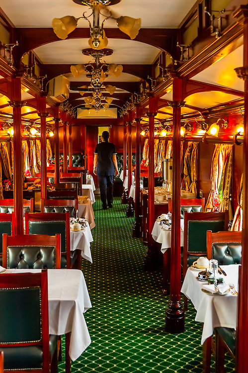 A pillared pre-1940s dining car on the luxury Rovos Rail train between Pretoria and Cape Town, South Africa.