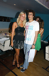 OLYMPIA SCARRY and ALEX DELLAL at a party to celebrate the publication of 'How to Party' by Yasmin Mills with illustrations by Olympia Scarry, held at the Fifth Floor Restaurant, Harvey Nichols, Knightsbridge, London on 3rd July 2006.<br />