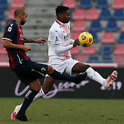 Danilo (Bologna) and Rafael Leao (Milan)  compete for the ball during the Serie A Tim match between Bologna FC 1909 and AC Milan at Stadio Renato Dall'Ara on January, 30 2021 in Bologna, Italy.