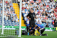 Referee Phil Dowd shares a joke with the fans as he waits for Sunderland player Steven Fletcher to receive treatment.  Barclays Premier league match, West Bromwich Albion v Sunderland at the Hawthorns in West Bromwich, England on Sat 21st Sept 2013. pic by Andrew Orchard, Andrew Orchard sports photography,