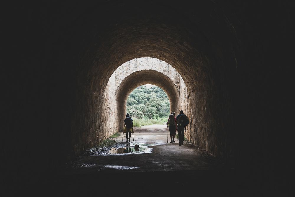 Pilgrims on the Camino de Santiago pass through a tunnel underneath the Autovía A-12, near the village of Lorca, Navarra, Spain. (June 4, 2018)<br /> <br /> DAY 8: PUENTE LA REINA TO ESTELLA: 22 KM