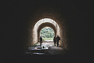 Pilgrims on the Camino de Santiago pass through a tunnel underneath the Autovía A-12, near the village of Lorca, Navarra, Spain. (June 4, 2018)<br />