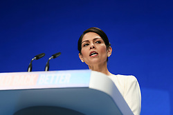 © Licensed to London News Pictures. 05/10/2021. Manchester, UK.  Home Secretary Priti Patel addresses the Conservative Party Conference on Tuesday. The annual Conservative Party Conference has returned to Manchester this year after being held online in 2020. Photo credit: Adam Vaughan/LNP