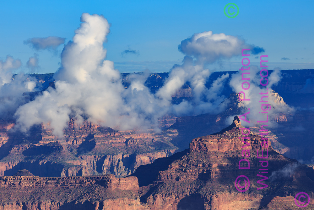 Morning fog towers near Angel's Gate formation (lower right) in the Grand Canyon, © David A. Ponton