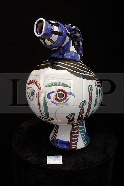 © licensed to London News Pictures. LONDON, UK  08/06/2011. A vase made by Picasso on sale at the Olympia International Fine Art & Antiques Fair with a value of up to £100,000. In total 30,000 items are on sale from 150 dealers and each is vetted for authenticity by a panel of experts. The show opens in Olympia tomorrow (Thursday) and runs for 11 days. Please see special instructions for usage rates. Photo credit should read CLIFF HIDE/LNP