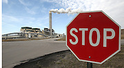 """022312tvstop.View from across the road with a vehicle traffic """"stop"""" sign at the Prairie State Energy Campus facility.  The facility is getting ready to begin generating electricity..TIM VIZER/BELLEVILLE NEWS-DEMOCRAT"""