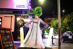 """© Licensed to London News Pictures . 27/10/2018. Manchester, UK. A drag artist on Sackville Street in Manchester's """" Gay Village """" . Revellers on a night out , many in fancy dress , on the weekend before Halloween . Photo credit: Joel Goodman/LNP"""
