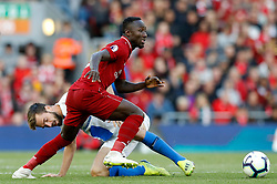 Liverpool's Naby Keita (front ) and Brighton & Hove Albion's Davy Propper battle for the ball during the Premier League match at Anfield, Liverpool.