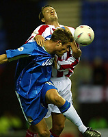 Photo. Aidan Ellis.<br />Wigan Athletic v Stoke City.<br />Nationwide Division 1.<br />14/10/2003.<br />Wigan's Geoff Horsfield and Stoke's Clint Hill