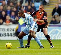 Photo: Leigh Quinnell.<br /> Coventry City v Ipswich Town. Coca Cola Championship.<br /> 19/11/2005. Coventrys Dele Adebola can't get away from Ipswichs' Jason De Vos.