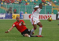 Photo: Steve Bond/Richard Lane Photography.<br />Egypt v Angola. Africa Cup of Nations. 04/02/2008. Wael Gomaa (L) fouls Flavio Amado (R)