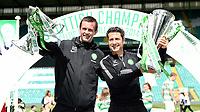 24/05/15 SCOTTISH PREMIERSHIP<br /> CELTIC v INVERNESS CT<br /> CELTIC PARK - GLASGOW<br /> Celtic manager Ronny Deila (left) and assistant John Collins celebrate with the Scottish League Cup and the Scottish Premiership trophy