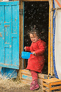 Kazakh child at ger<br /> Autumn grazing ground<br /> Altai Mountains<br /> Bayan Olgii Province<br /> Western Mongolia