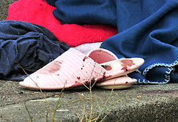 © Licensed to London News Pictures. 19/08/2018<br /> New Eltham, UK. A blood covered slipper at the scene of a Hammer attack on two women in New Eltham, south east London. Police are currently searching for 27 year old Joe Xuereb in connection with the attack. <br /> Photo credit: Grant Falvey/LNP
