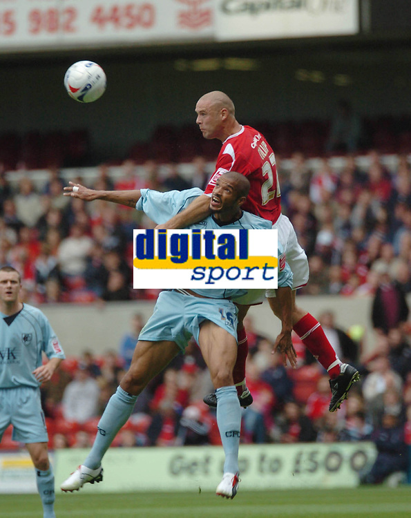 Photo: Ian Hebden.<br /> <br /> Nottingham Forest v Chesterfield. Coca Cola League 1. 02/09/2006.<br /> <br /> Forests Danny Cullip (L) wins a header from Chesterfields Aaron Downes (L).