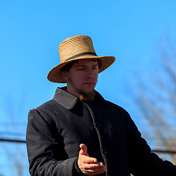 Gordonville, PA, USA - March 10, 2012: An Amish man watches for bids at a public mud sale to benefit the Gordonville Volunteer Fire Company in Lancaster County, PA.