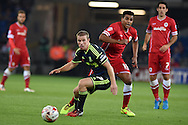 Grant Leadbitter of Middlesbrough © holds off Cardiff's Tom Adeyemi. Skybet football league championship match, Cardiff city v Middlesbrough at the Cardiff city stadium in Cardiff, South Wales on Tuesday 16th Sept 2014<br /> pic by Andrew Orchard, Andrew Orchard sports photography.