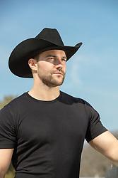 sexy cowboy looking off