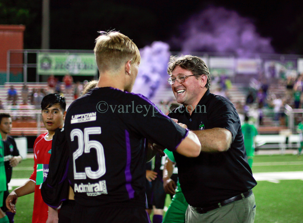 13 June 2015. New Orleans, Louisiana.<br /> National Premier Soccer League. NPSL. <br /> Manager Kenny Farrell enjoys the win as the New Orleans Jesters take a 3-2 victory against Texas' Premier Soccer League's (TPSL) runner-up, the Houston Hurricanes at home in the Pan American Stadium.<br /> Photo; Charlie Varley/varleypix.com