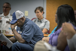 July 27, 2017 - St. Paul, Minnesota, U.S. - JOHN THOMPSON, a friend of Philando Catile reacts after the Board of Peace Officer Standards and Training voted against a request from Gov. Dayton that a new law enforcement training fund approved by the Legislature this year be named for Philando Castile on Thursday. (Credit Image: © Elizabeth Flores/TNS via ZUMA Wire)