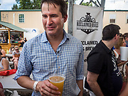 17 AUGUST 2019 - DES MOINES, IOWA: Representative SETH MOULTON (D-MA) drinks a craft beer at the Iowa State Fair Saturday.  Moulton, a US Marine veteran who served in Iraq, is running to be the Democratic candidate for the US Presidency in 2020 and spent Saturday campaigning at the fair. Iowa traditionally hosts the the first selection event of the presidential election cycle. The Iowa Caucuses will be on Feb. 3, 2020.         PHOTO BY JACK KURTZ