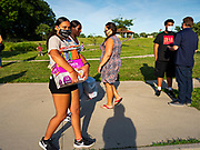 25 JUNE 2020 - DES MOINES, IOWA: A supporter of Black Lives Matter carries trash can liners being donated to help the homeless to a car. Nearly 100 volunteers came to a community support event organized by Black Lives Matter in Good Park in Des Moines. They sorted supplies donated to BLM, including food, sanitary supplies, first aid supplies, batteries, blankets, tents, and bottled water. The emergency packages will be distributed to homeless people in Des Moines.       PHOTO BY JACK KURTZ