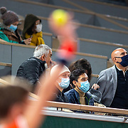 PARIS, FRANCE October 03. A ball boy presents the ball for the serving player as spectators wearing masks watch from the stands during the Novak Djokovic of Serbia match against Daniel Elahi Galan of Colombia in the third round of the singles competition on Court Philippe-Chatrier during the French Open Tennis Tournament at Roland Garros on October 3rd 2020 in Paris, France. (Photo by Tim Clayton/Corbis via Getty Images)