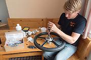 Mats stelt het wiellager af. Het Human Power Team Delft en Amsterdam (HPT), dat bestaat uit studenten van de TU Delft en de VU Amsterdam, is in Senftenberg voor een poging het uurrecord te verbreken op de Dekrabaan met de VeloX4. In september wil het HPT daarna een poging doen het wereldrecord snelfietsen te verbreken, dat nu op 133 km/h staat tijdens de World Human Powered Speed Challenge.<br /> <br /> The Human Power Team Delft and Amsterdam, consisting of students of the TU Delft and the VU Amsterdam, is in Senftenberg (Germany) for the attempt to set a new hour record on a bicycle with the special recumbent bike VeloX4. They also wants to set a new world record cycling in September at the World Human Powered Speed Challenge. The current speed record is 133 km/h.