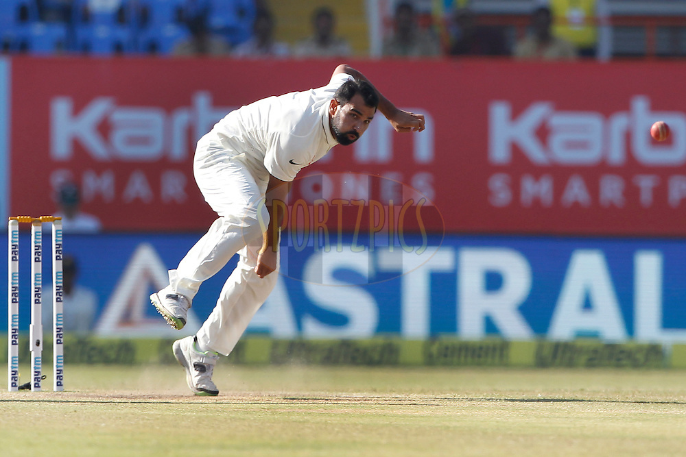 Mohammed Shami of India bowls a delivery during day 5 of the first test match between India and England held at the Saurashtra Cricket Association Stadium , Rajkot on the 13th November 2016.<br /> <br /> Photo by: Deepak Malik/ BCCI/ SPORTZPICS