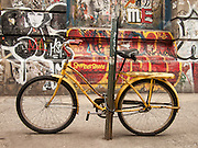 A bicycle chained to a lost outside Jay Maisel's former house in the Bowery.