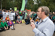 Ewan Jones from the Green Party Somerset speaks at the Rise For Climate Change event held outside Tate Modern in London, England, United Kingdom on September 8th 2018. Tens of thousands of people joined over 830 actions in 91 countries under the banner of Rise for Climate to demonstrate the urgency of the climate crisis. Communities around the world shined a spotlight on the increasing impacts they are experiencing and demanded local action to keep fossil fuels in the ground. There were hundreds of creative events and actions that challenged fossil fuels and called for a swift and just transition to 100% renewable energy for all. Event organizers emphasized community-led solutions, starting in places most impacted by pollution and climate change. Photographed for 350.org
