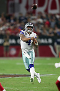 Dallas Cowboys quarterback Dak Prescott (4) leaps and throws a pass during the 2017 NFL week 3 regular season football game against the Arizona Cardinals, Monday, Sept. 25, 2017 in Glendale, Ariz. The Cowboys won the game 28-17. (©Paul Anthony Spinelli)