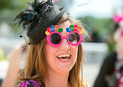 TODAY PICTURE © Licensed to London News Pictures. 06/06/2014. Epsom, UK Ladies Day today 6th June 2014 at Epsom 2014 Investic Derby Festival in Surrey. Traditionally, elegant, fashionable racegoers gather for a classic day's racing at Epsom Racecourse, Surrey. Photo credit : Stephen Simpson/LNP