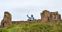 North Berwick, East Lothian, Scotland, UK, Tantallon Castle reopening: Historic Environment Scotland reopens more of their properties today including this 14th century Medieval curtain wall clifftop castle which overlooks the Firth of Forth. Andrew Spratt, HES custodian and Medieval enthusiast welcomes the first visitors, dressed appropriately as a knight in Medieval armour with a face mask. <br /> Sally Anderson | EdinburghElitemedia.co.uk