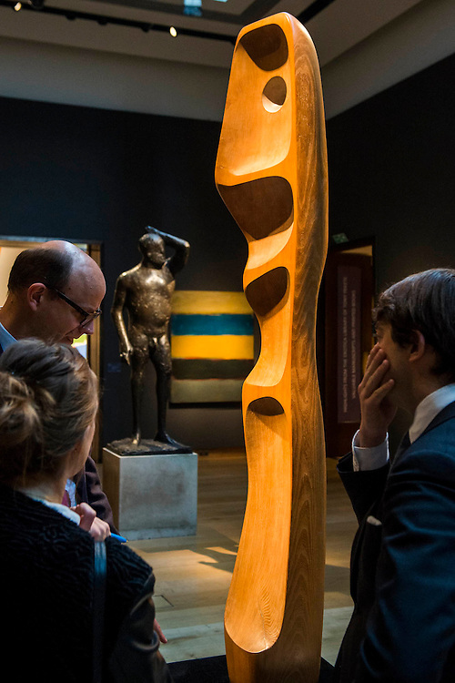 Figure (Sunion) by Dame Barbara Hepworth with First man by Dame Elisabeth Fink in the background  - Christie's Modern British and Irish Art Sale which will take place on 19 November 2014. Featuring 35 lots, the auction includes  examples of 20th century British sculpture and painting, such as: John Duncan Fergusson's Poise (estimate: £80,000-120,000); six paintings by L.S. Lowry, led by Coal Barge (estimate: £700,000-1,000,000);  Euan Uglow's masterpiece entitled Three In One (estimate: £500,000-800,000; Figure (Sunion) by Dame Barbara Hepworth (estimate: £600,000-800,000); and sculpture by leading artists of the genre including Henry Moore, Lynn Chadwick, Dame Elisabeth Frink, and Naum Gabo.