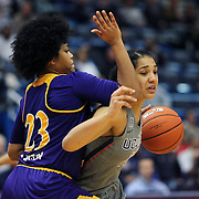 HARTFORD, CONNECTICUT- JANUARY 4: Gabby Williams #15 of the Connecticut Huskies drives past Dominique Claytor #23 of the East Carolina Lady Pirates  during the UConn Huskies Vs East Carolina Pirates, NCAA Women's Basketball game on January 4th, 2017 at the XL Center, Hartford, Connecticut. (Photo by Tim Clayton/Corbis via Getty Images)