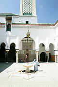 The view inside this mosque is restricted by non-muslims and contains the body of Idriss II, a founding father of Fes, Morocco. A fountain in the center is used for washing for prayer, a woman prepares on Monday afternoon, May 28, 2007. (PHOTO BY TIMOTHY D. BURDICK)