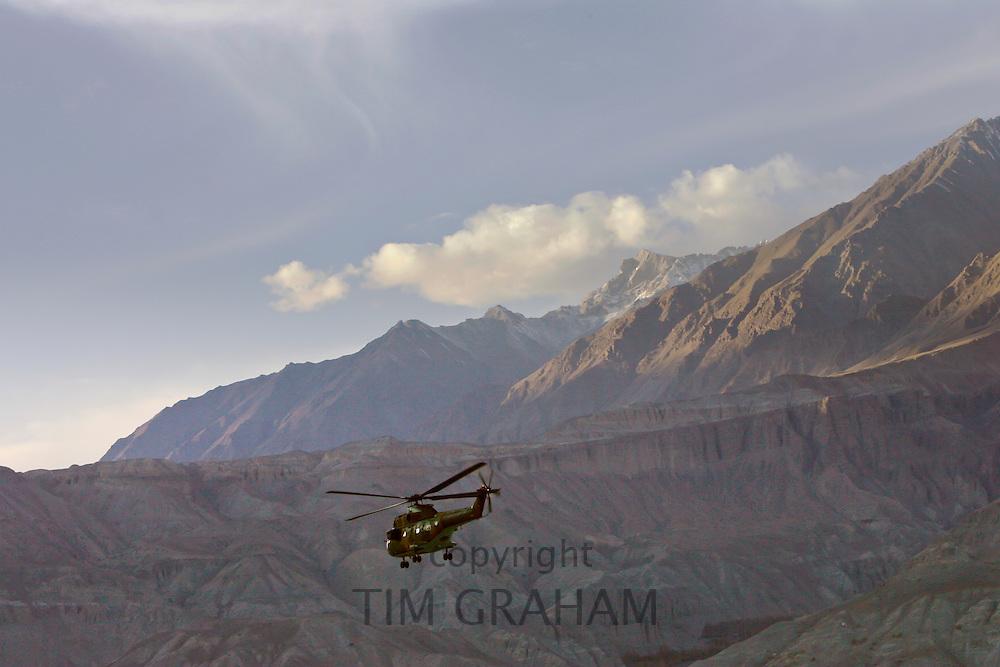 Helicopter flies through valleys of Karokoram Mountains, Skardu Valley, North Pakistan