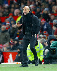 Manchester City manager Pep Guardiola gestures on the touchline during the Premier League match at Old Trafford, Manchester.