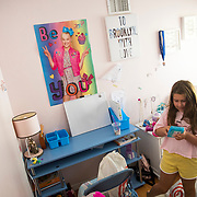 """Erin Jundef takes her daughter, Brooklyn, to Target for back to school shopping with a list provided to her by Brooklyn's 4th grade teacher. Brooklyn then took to setting-up her bedroom with a new desk where she will be """"in school"""" next month. Erin has forbid her daughter from being in bed or in other places inconsistent with a academic environment"""