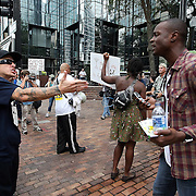 A man on the street (right) argues with a member of the Bible Believers group during the Republican National Convention in Tampa, Fla. on Wednesday, August 29, 2012. (AP Photo/Alex Menendez)