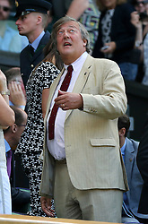 @ London News Pictures. 09/07/2015.<br /> Stephen Fry watches Serena Williams beat Maria Sharpova in the semi finals of the Ladies Wimbledon Tennis Championships today.. Photo credit:LNP